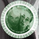 A distorted image of music duo Intimatchine whose faces stare out of a warped background image.